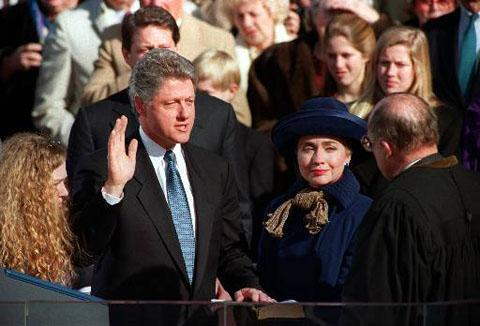 Bill Clinton takes the oath of office from Chief Justice William Rehnquist at the Capitol on January 20, 1993. Hillary Rodham Clinton and their daughter Chelsea are at his side and behind him is Vice
