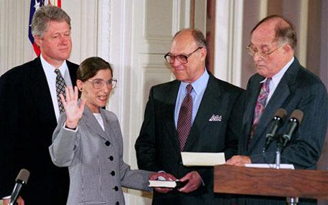 President Bill Clinton watches as his nominee for Supreme Court Justice, Ruth Bader Ginsburg, takes the oath of office, in 1993