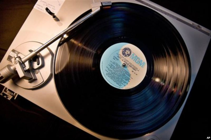 An old vinyl record album on a turntable