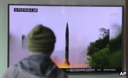 A man in South Korea watches a TV news program showing a missile launch conducted by North Korea, Oct. 20, 2016.