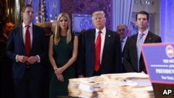 President-elect Donald Trump, accompanied by his family, arrives a news conference in the lobby of Trump Tower in New York, Jan. 11, 2017.