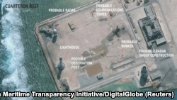 A satellite image released by the Asian Maritime Transparency Initiative at Washington's Center for Strategic and International Studies shows construction of possible radar tower facilities in the Spratly Islands in the disputed South China Sea in this im