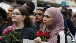 Mourners listen to speakers June 21, 2017, in Reston, Va., during a vigil in honor of Nabra Hassanen. Islamic leaders say the beating death of Nabar looks all too much like a hate crime.