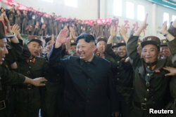 North Korean leader Kim Jong Un reacts with scientists and technicians of the DPRK Academy of Defence Science after the test-launch of the intercontinental ballistic missile Hwasong-14