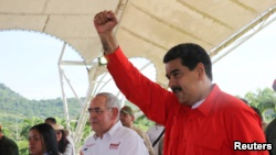Venezuela's President Nicolas Maduro gestures during a meeting with workers at the Francisco de Miranda hydroelectric complex in Caruachi, Venezuela July 6, 2017. Miraflores Palace/Handout via Reuters