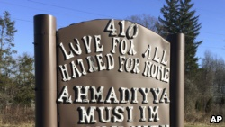 FILE - A sign bearing the words 'Love for all, hatred for none' stands outside a mosque in Meriden, Connecticut, Feb. 27, 2016.