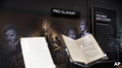 An exhibit discussing slavery in the United States is displayed inside the Museum of the Bible, Monday, Oct. 30, 2017, in Washington. (AP Photo/Jacquelyn Martin)