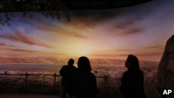 People preview the exhibit 'The World of Jesus of Nazareth' at the Museum of the Bible, Monday, Oct. 30, 2017, in Washington. (AP Photo/Jacquelyn Martin)