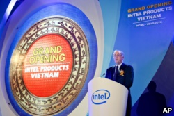 FILE - Intel CEO Paul Otellini makes his speech at the opening ceremony of the assembly and test facility of Intel's chipset products at Saigon High Tech Park, Ho Chi Minh city, Vietnam, on Friday, October 29, 2010.