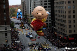 A giant Charlie Brown balloon makes floats down 6th Avenue in New York City during the 90th Macy's Thanksgiving Day Parade, 2016. (REUTERS/Saul Martinez)