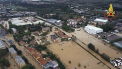 Scientists say extreme weather events like this flood in the city of Leghorn, Italy, following floods in September 2017 are becoming more common because of climate change.