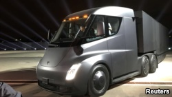 Tesla's new electric semitractor-trailer is unveiled during a presentation in Hawthorn, California, Nov. 16, 2017.