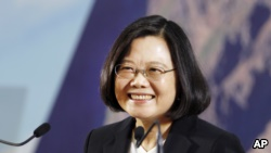 Taiwan's President Tsai Ing-wen delivers a speech during the year-end media event at the National Chung-Shan Institute of Science & Technology in Taoyuan county, Taiwan, Friday, Dec. 29, 2017. (AP Photo/Chiang Ying-ying)