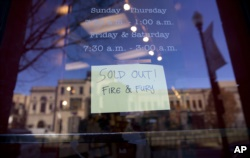 A sign posted at the door for Kramerbooks & Afterwords Cafe shows that the book 'Fire and Fury: Inside the Trump White House' is sold out at the bookstore located in the Dupont Circle neighborhood in Washington, Friday, Jan. 5, 2018. (AP Photo)
