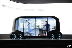 Toyota's e-Pallet concept is unveiled during a news conference at CES International, Monday, Jan. 8, 2018, in Las Vegas. (AP Photo/Jae C. Hong)