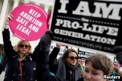 Pro-life and pro-choice activists gather at the Supreme Court for the National March for Life rally in Washington, D.C., Jan. 27, 2017.