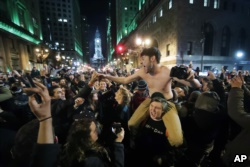 Philadelphia Eagles fans celebrate the team's victory in the NFL Super Bowl 52