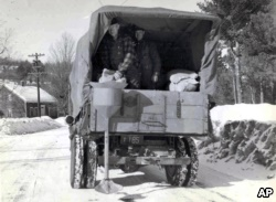 This circa 1940s photo released by the New Hampshire Department of Transportation archives shows salt being applied for anti-icing on a New Hampshire roadway.