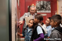 Mas Yamashita leads a school tour at the Japanese American National Museum where he volunteers every Friday. Yamashita, an American born in California, is one of the 120,000 people held in an internment camp during the WWII. (Courtesy: Japanese American N