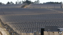 Looking like a vineyard, 206,000 polycrystalline solar panels make up the 540-acre site solar project in Lamar County near Sumrall, Miss., Wednesday, March 7, 2018. (AP Photo/Rogelio V. Solis)