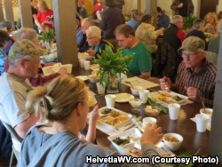 Community members enjoying ramps at the annual Ramp Supper in Helvetia, West Virginia.