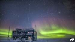 This undated photo provided by NOAA in May 2018 shows aurora australis near the South Pole Atmospheric Research Observatory in Antarctica. (Patrick Cullis/NOAA via AP)