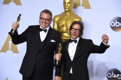 Adam McKay, left, and Charles Randolph pose with the award for best adapted screenplay for 'The Big Short' at the 2016 Oscars. (Photo by Jordan Strauss/Invision/AP)