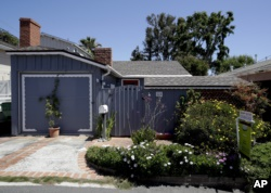This tiny cottage on Lombardy Lane in Laguna Beach, Calif. is for sale at just shy of $1 millions is shown Friday, May 25, 2018. This one bedroom home is 595 square feet and is a few blocks from the ocean. (AP Photo/Chris Carlson)