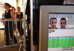 FILE - Facial recognition technology is used to screen people before they visit the Statue of Liberty in New York, US.