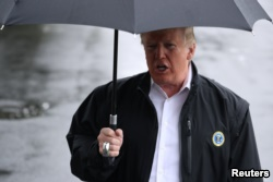 U.S. President Donald Trump talks to reporters from the White House in Washington, October 15, 2018 before leaving for Florida to inspect hurricane damage there.