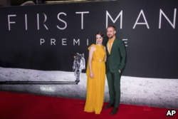Claire Foy and Ryan Gosling attend the 'First Man' premiere at the National Air and Space Museum of the Smithsonian Institution, October 4, 2018.