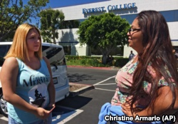 In this April, 28, 2015 photo, Adriana Garay, 29, right, talks with her niece, Haley Sandoval, 17, a student at the now-closed Everest College in Industry, California, hoping to get their transcripts and information on loan forgiveness.