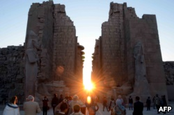 The sun rises behind the Temple of Karnak during the alignment of the winter solstice sunrise to the temple in the southern Egyptian city of Luxor on December 22, 2015.