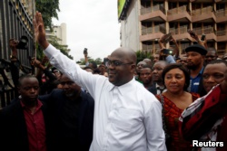 Felix Tshisekedi, leader of the Congolese main opposition party, the Union for Democracy and Social Progress (UDPS) who was announced as the winner of the presidential elections gestures to his supporters in Kinshasa, Democratic Republic of Congo, Jan. 10