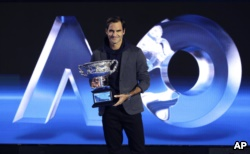 Defending men's champion Switzerland's Roger Federer holds the Norman Brookes Challenge Cup during a photo opportunity at the official draw ceremony ahead of the Australian Open tennis championships in Melbourne, Australia, Thursday, Jan. 10, 2019. (AP Ph