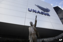 The statue of former Argentinian President Nestor Kirchner stands at the entrance to the Union of South American Nations, UNASUR, building, near Quito, Ecuador, Dec. 19, 2018. (AP Photo/Dolores Ochoa)