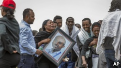 Ethiopian relatives of crash victims mourn and grieve at the scene where the Ethiopian Airlines Boeing 737 Max 8 crashed shortly after takeoff on Sunday killing all 157 on board, near Bishoftu, south-east of Addis Ababa, in Ethiopia Thursday, March 14, 20