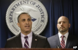 FBI Special Agent in Charge Boston Division Joseph Bonavolonta, left, and U.S. Attorney for District of Massachusetts Andrew Lelling, right, face reporters as they announce indictments at a news conference on March 12, 2019