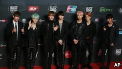 Members of South Korea boy group BTS pose for the photographers on the red carpet of the 2015 Mnet Asian Music Awards (MAMA) in Hong Kong, Wednesday, Dec. 2, 2015. (AP Photo/Kin Cheung)