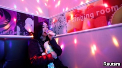 Japanese Yuuka Hasumi, 17, who wants to become a K-pop star, sings a song as she spends time after class, in the Hongdae area of Seoul, South Korea, April 3, 2019.