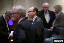 Senator Clyde Chambliss (R), center, is seen with other senators during a state Senate vote on the strictest anti-abortion bill in the United States at the Alabama Legislature in Montgomery, Alabama, May 14, 2019.