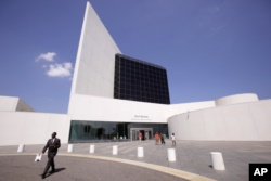 FILE - This Aug. 19, 2009, file photo shows the entrance of the John F. Kennedy Presidential Library and Museum, designed by architect I.M. Pei, in Boston. (AP Photo/Steven Senne, File)