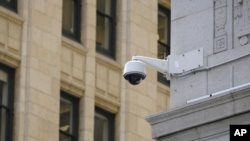 In this photo taken Tuesday, May 7, 2019, is a security camera in the Financial District of San Francisco. (AP Photo/Eric Risberg)