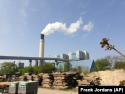 A chimney billows out steam at Berlin's Reuter West thermal power station on Wednesday, April 24, 2019. The energy company, together with a Swedish start-up, is testing the use of salt to store heat, which accounts for more than half the power consumed in