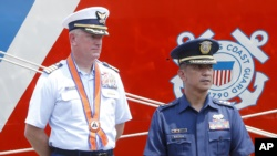 Captain John Driscoll, left, commanding officer of the U.S. Coast Guard National Security Cutter Bertholf (WMSL 750), and Philippine Coast Guard Spokesman Commander Armand Balilo, talk to the media during a port call by the U.S. cutter Wednesday, May 15,