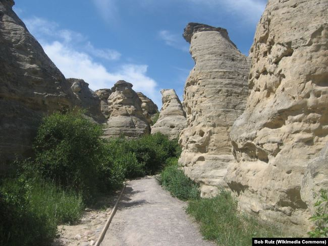Carvings are seen in rock structures called hoodoos in Writing-on-Stone Provincial Park, Alberta, Canada.