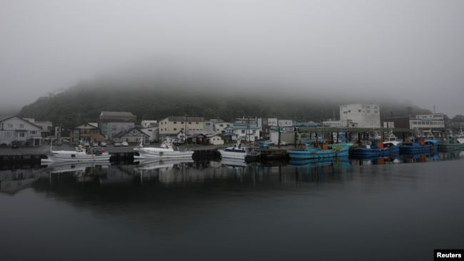 A heavy shroud of morning mist fills a port in Rausu, Hokkaido, Japan, July 2, 2019. (Reuters)