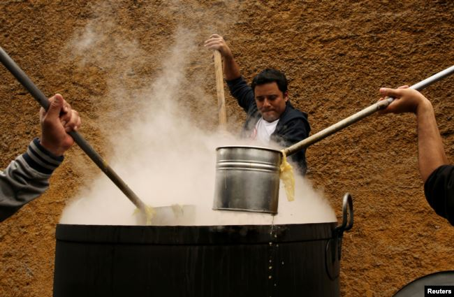 Volunteers cook soup called 'porciuncula' during a religious activity at the convent of Los Descalzos, in Lima, Peru, August, 2017.