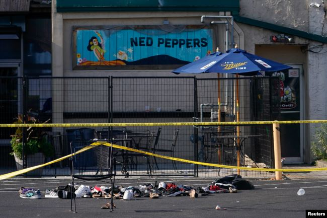 Shoes are piled in the rear of Ned Peppers Bar at the scene after a mass shooting in Dayton, Ohio, U.S. August 4, 2019.