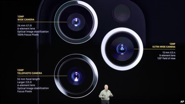Phil Schiller talks about the new iPhone 11 Pro and Max, during an event to announce new products Tuesday, Sept. 10, 2019, in Cupertino, Calif. (AP Photo/Tony Avelar)